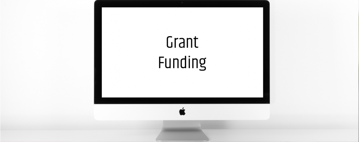 iMac that has the word grants on the screen